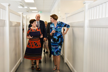 Dame Patsy and Sir David touring the Doggy Day-care Centre