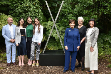 Dame Patsy with Dame Silvia Cartwright, Gill Gatfield and Gill's family standing by the Zealandia sculpture