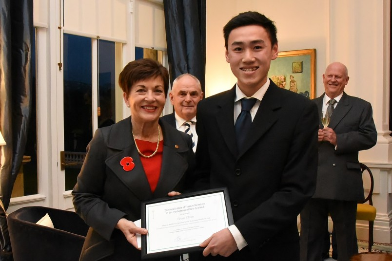 An image of Dame Patsy presenting the winning prize to Sean Chan
