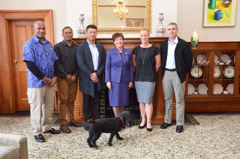 Image of Dame Patsy with a group of Warrant Officers from Tonga, Fiji, Singapore and Australia