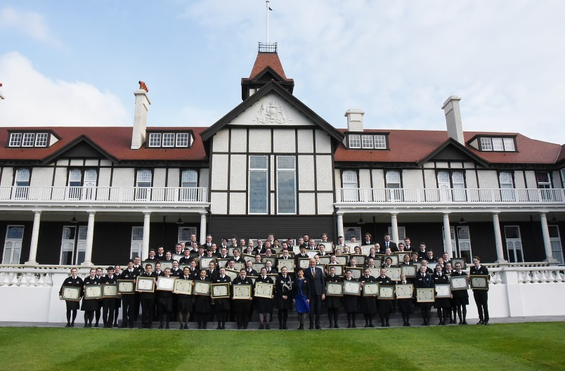 Image of all 90 St John Grand Prior Award recipients with Dame Patsy and Sir David outside Government House