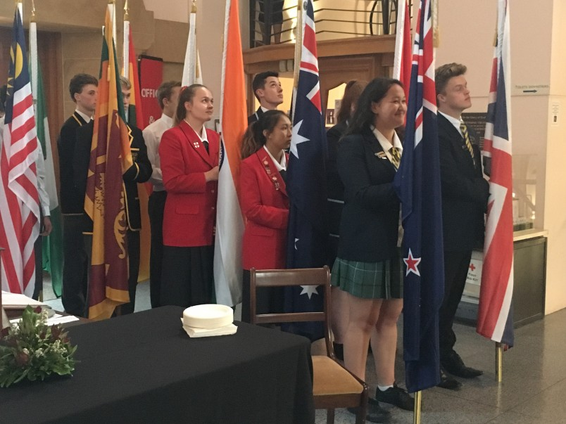 an image of Students carrying flags of the Commonwealth