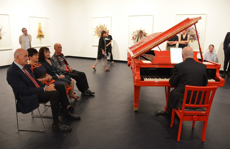 Image of Micahael Houston playing the Michael Parekowhai piano sculpture