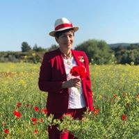 an image of Dame Patsy and poppies at Gallipoli
