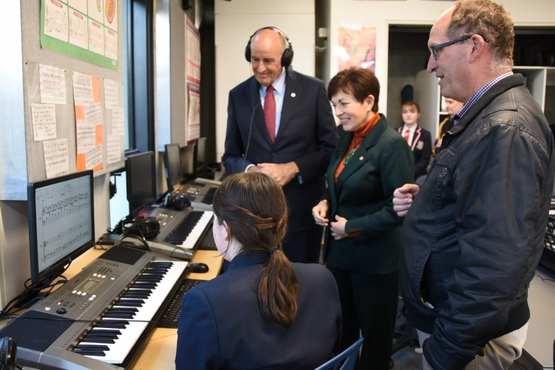 an image of Dame Patsy and Sir David hearing a student's composition in the music lab