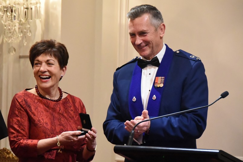 an image of Police Commissioner Mike Bush presenting Dame Patsy with the medal
