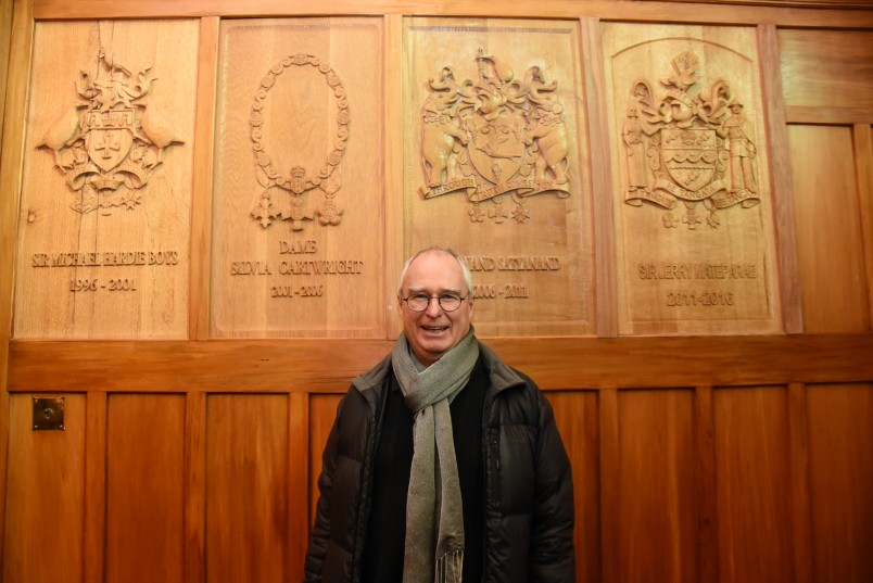 Image of Paul Deans with his carvings