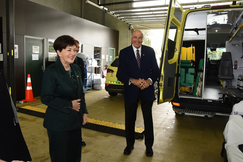 an image of Dame Patsy and Sir David at the St John Headquarters garage