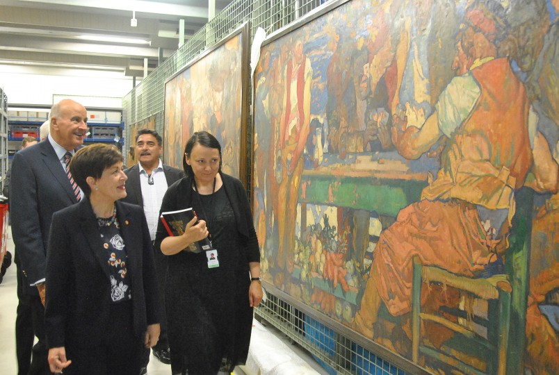 Image of Te Papa Head of Art, Charlotte Davy escorting Dame Patsy and Sir David into the stacks