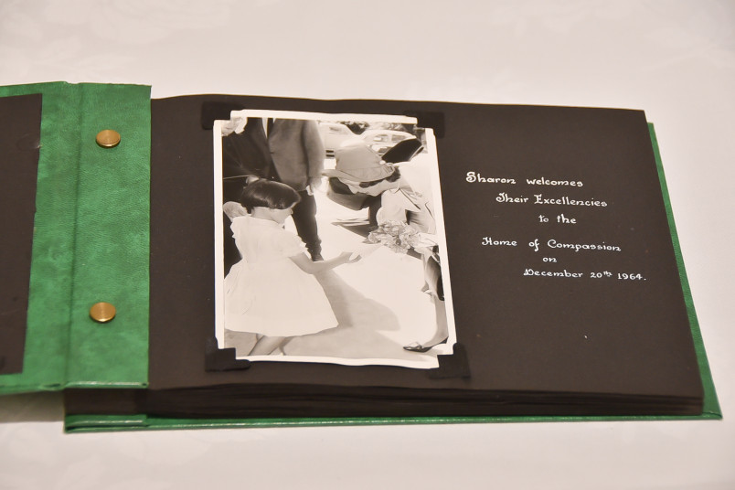 Image of a photo album from a previous Governor-General visit - Lady Fergusson receives flowers