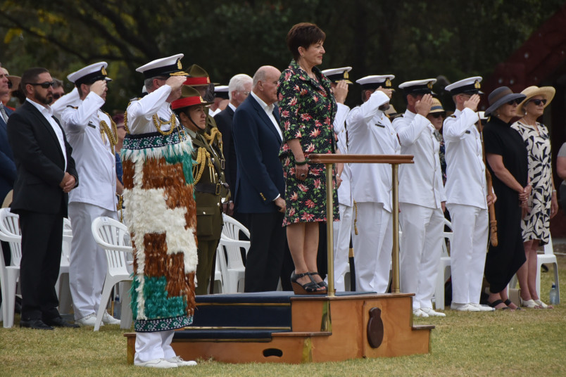 Dame Patsy Reddy on a podium observing the Guard