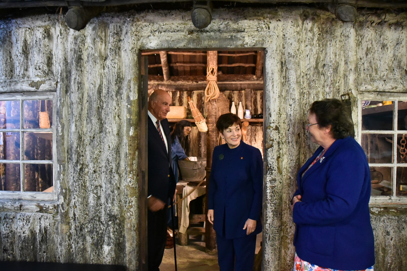 Their Excellencies with a replica settler house, built without nails
