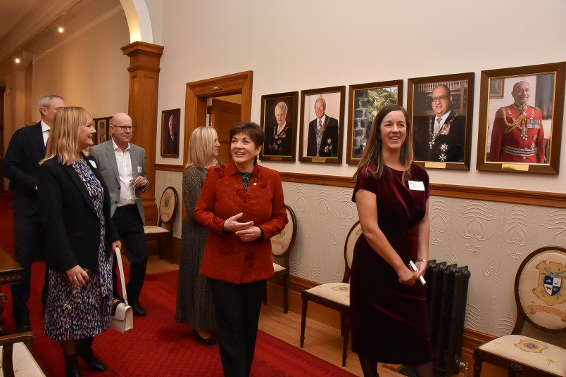 Dame Patsy and Te Papa Foundation guests with the Government House portraits of previous Governors-General