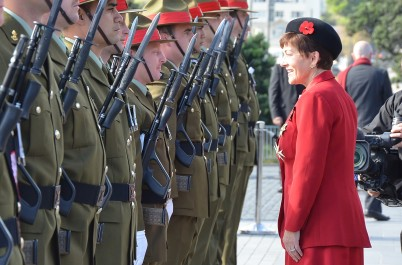 Image - Dame Patsy Reddy inspects the honour guard at Pukeahu National War Memorial Park