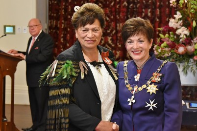Image of Dr Peetikuia Wainui, of Gisbornereceiving the insignia of an MNZM from Dame Patsy Reddy