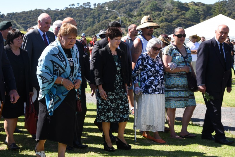 The official party approaching the wharenui.