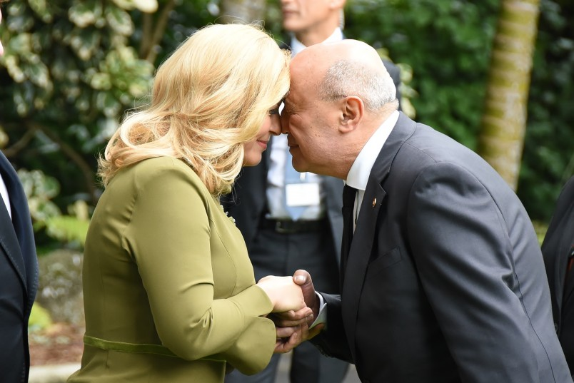 Image of Her Excellency Kolinda Grabar-Kitarovic doing the hongi with kaumatua Prof Piri SciasciaD