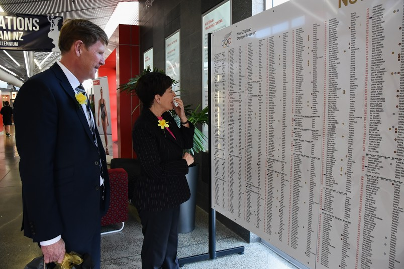 An image of Dame Patsy and Mike Stanley looking at the honour board of NZ Olympic athletes