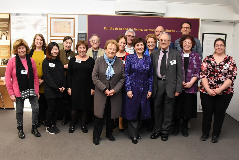 An image of Sir David and Dame Patsy with staff and volunteers