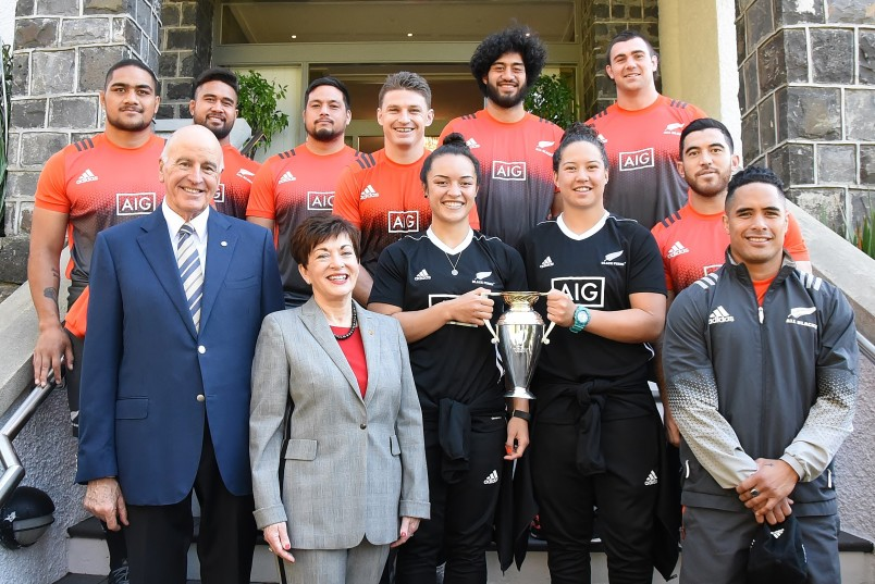 Image of Dame Patsy and Sir David with All Blacks and Black Ferns