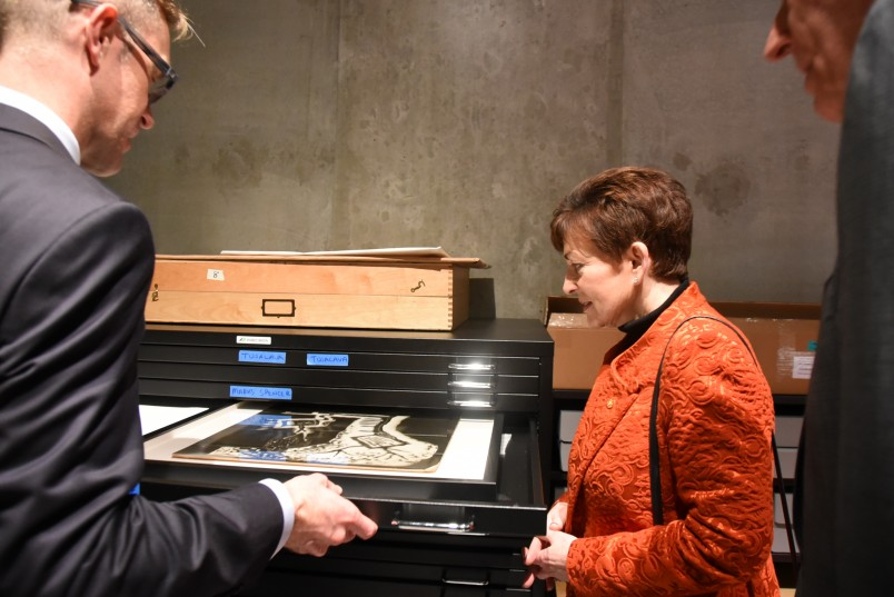 An image of Director Simon Rees shows Dame Patsy Len Lye paper works