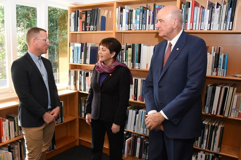 Image of Dame Patsy and Sir David being shown around the offices of the New Zealand AIDS Foundation