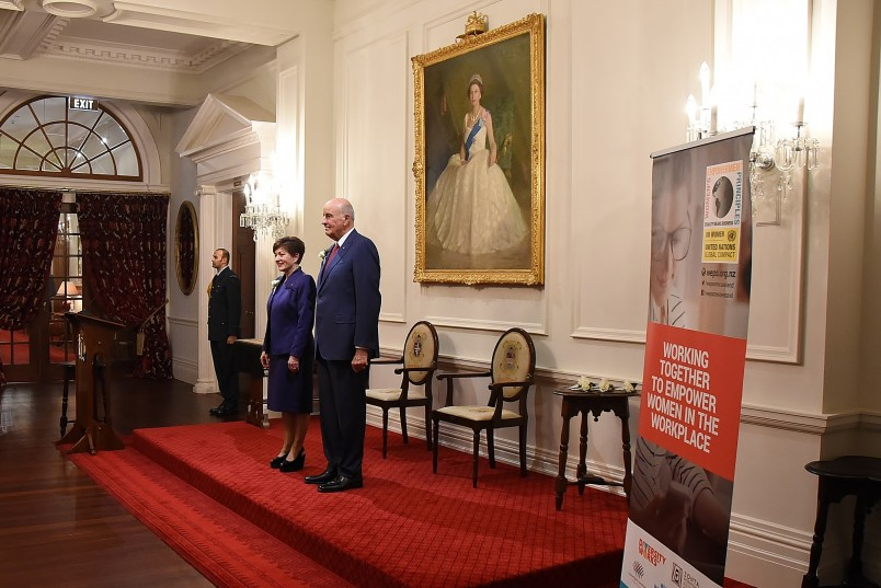 Image of Dame Patsy and Sir David standing for 'God Save the Queen'