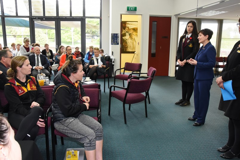 an image of Dame Patsy responding to questions from the staff