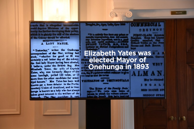 Image of a big screen showing footage of New Zealand's (and the British Empire's) first female mayor, Elizabeth Yates