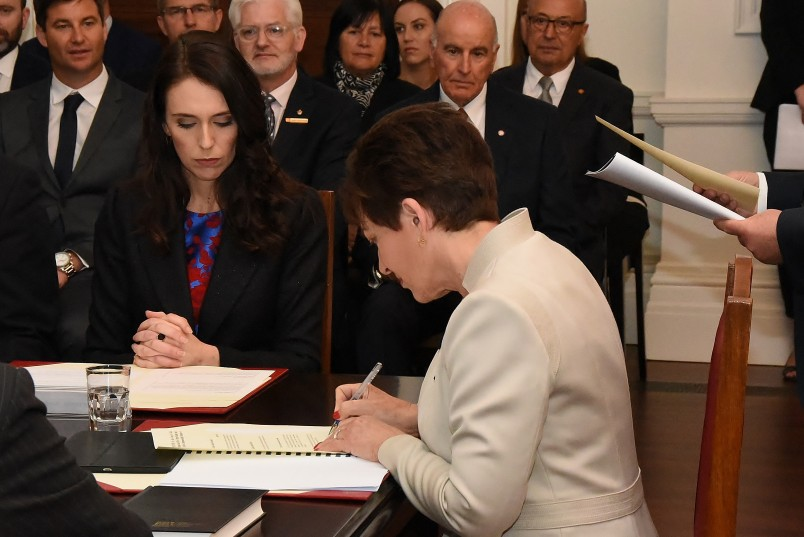 Image of Dame Patsy signing the warrant appointing Jacinda Ardern as Prime Minister