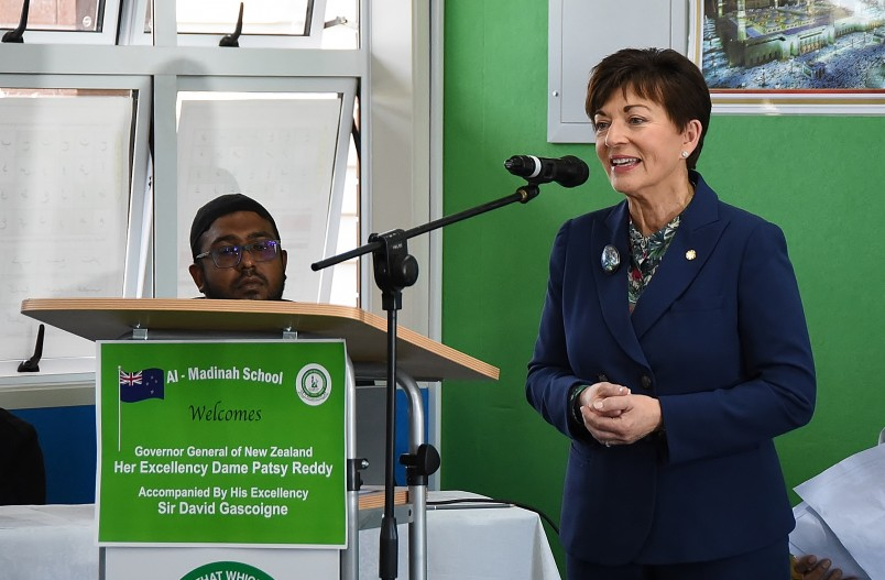 Image of Dame Patsy speaking at Al-Madinah School's assembly