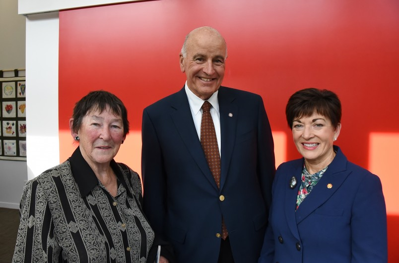 Image of Dame Patsy and Sir David with hospice volunteer Christine Sanderson, the force behind the highly sucessful weekly garage sales