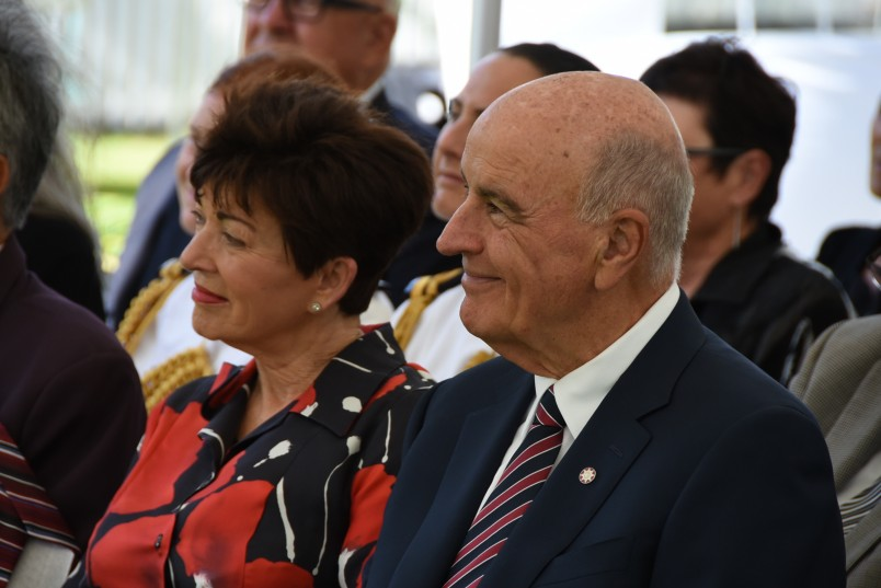 an image of Dame Patsy and Sir David enjoying the korero at Haratu Marae