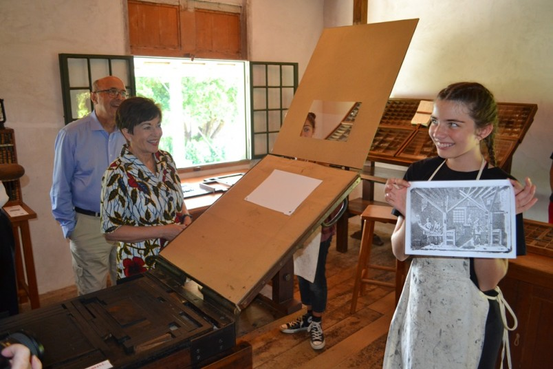 an image of Dame Patsy witnessed and a Russell School student with an image she printed on this heritage machinery