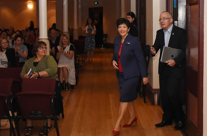 Image of Dame Patsy arriving at Auckland Town Hall escorted by Auckland Council Chief Executive, Stephen Towne