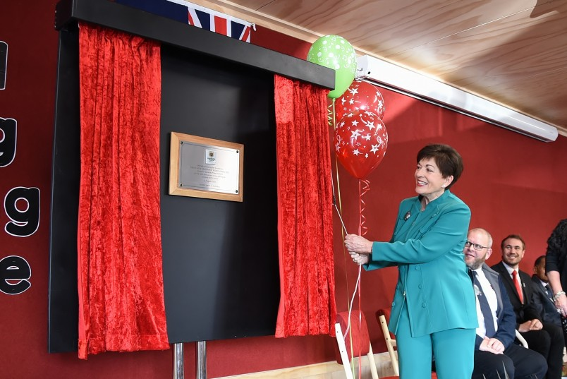 an image of Dame Patsy unveiling a plaque to mark the official opening