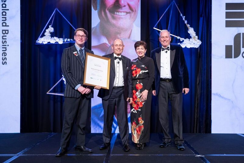 an image of Dame Patsy with Domenic Johnson, and inductees Graeme Turner and Craig Turner
