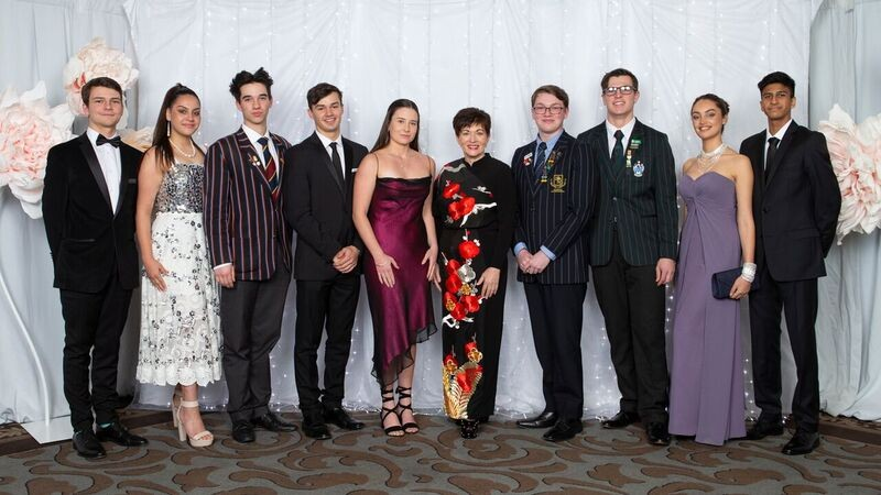 an image of Dame Patsy and the YES Student Ambassadors