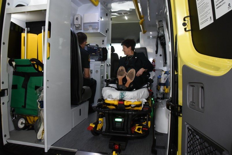 an image of Dame Patsy trying out the patient experience in a top of the range ambulance