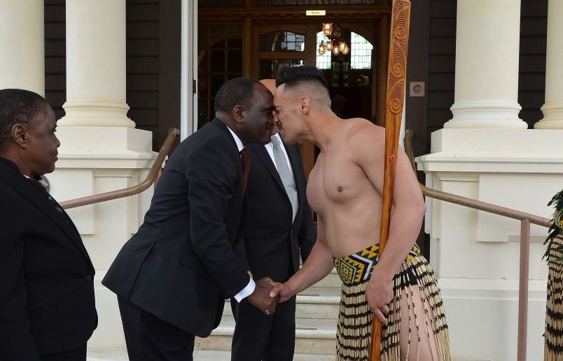 an image of HE Mr Grenenger Kidney Msulira Banda greeting a member of the cultural party