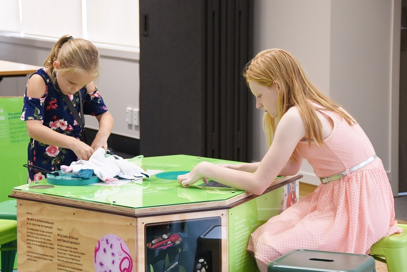 Image of Isabelle and Amelia Bowen trying out some of the features in the Education Centre