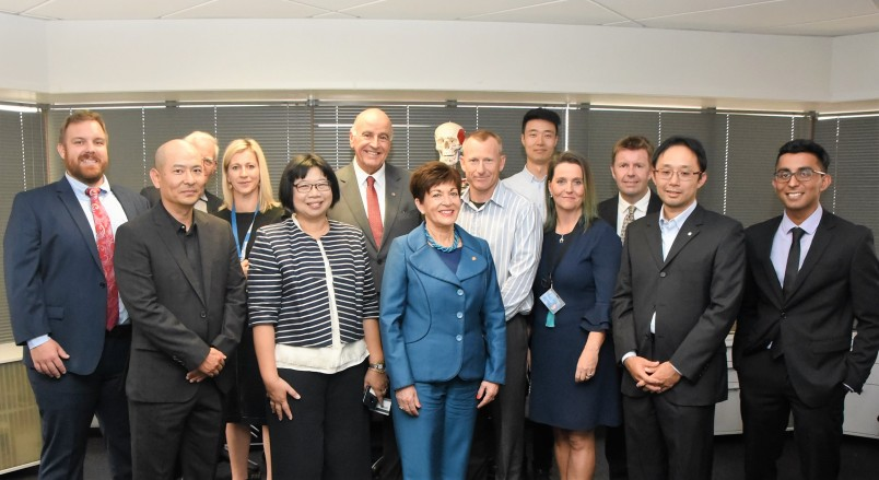 IMage of Dame Patsy and Sir David with academic and research staff at the Auckland Bioengineering Institute
