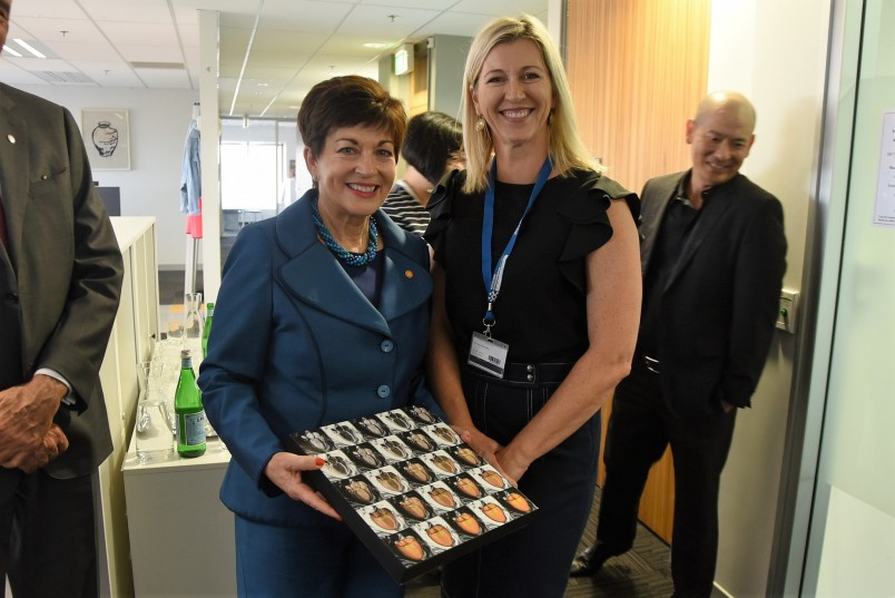 Image of Prof Merryn Tawhai presenting Dame Patsy with an art work