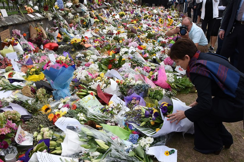 Image of Dame Patsy laying flowers for the victims at Hagley Park