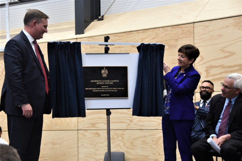 Dame Patsy and Aaron Snodgrass unveil a plaque in DIlworth's new sports centre