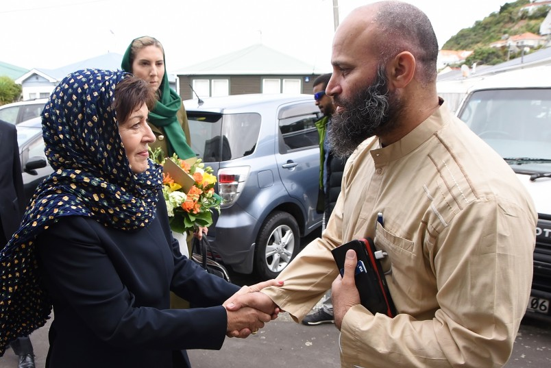 Image of Dame Patsy being greeted by Tahir Nawaz, President of the International Muslim Association of New Zealand