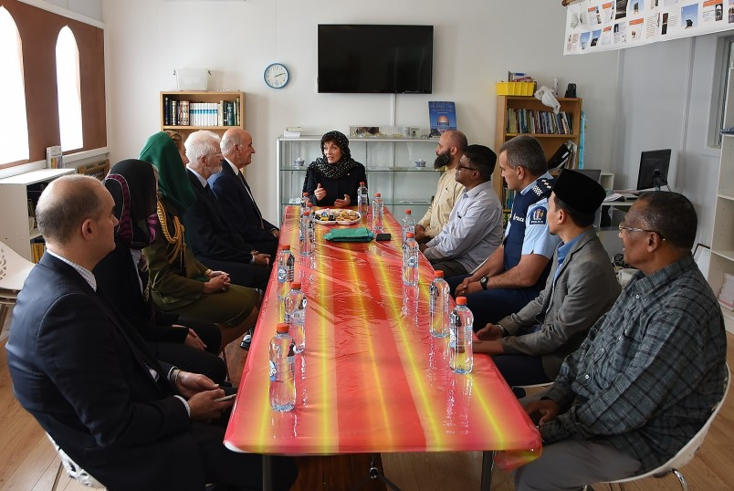 Image of Dame Patsy talking with members of the Wellington Muslim community