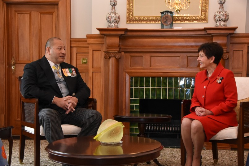 Image of Dame Patsy and King Tupou VI chatting in the Liverpool Room
