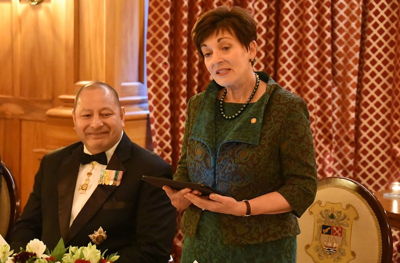 IMage of Dame Patsy speaking at the dinner for the King and Queen of Tonga