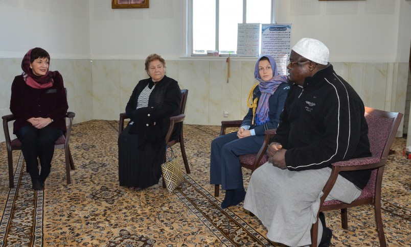 The imam of the Linwood Islamic Centre speaking to Dame Patsy